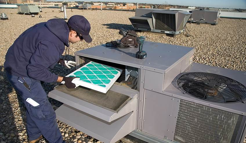 Installation of an air filter in a commercial system.