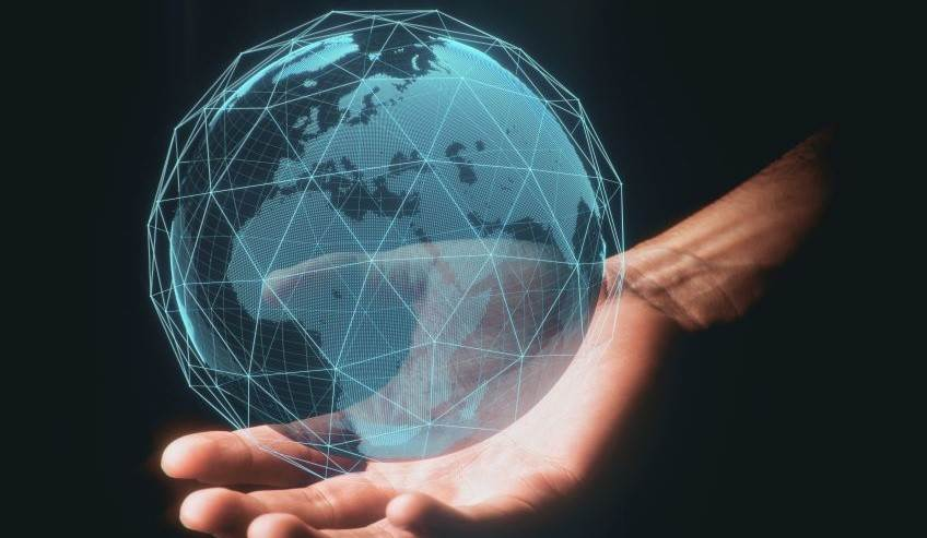 Man holding a connected globe